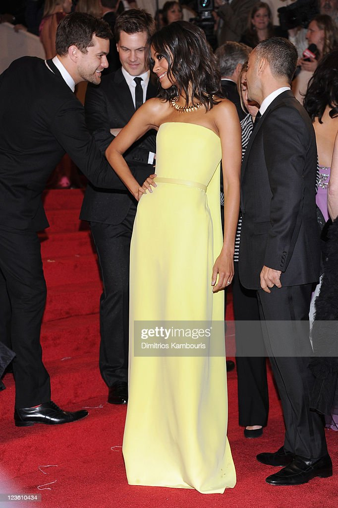 Actor Joshua Jackson (L) and actress Zoe Saldana (R) attends the 'Alexander McQueen: Savage Beauty' Costume Institute Gala at The Metropolitan Museum of Art on May 2, 2011 in New York City.