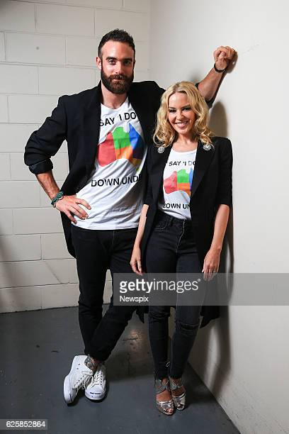 SYDNEY NSW Actor Joshua Sasse and singer Kylie Minogue pose backstage at the ARIA Awards 2016 at Star City Casino in Sydney New South Wales