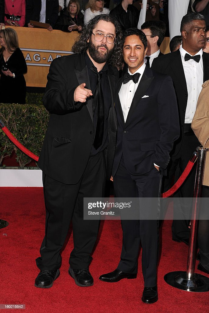Actor Judah Friedlander and actor Danny Pudi arrive at the 19th Annual Screen Actors Guild Awards held at The Shrine Auditorium on January 27 2013 in...