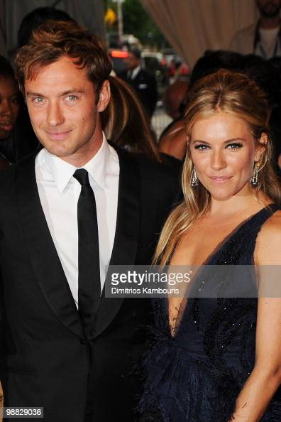 Actor Jude Law and actress Sienna Miller attend the Costume Institute Gala Benefit to celebrate the opening of the 'American Woman Fashioning a...