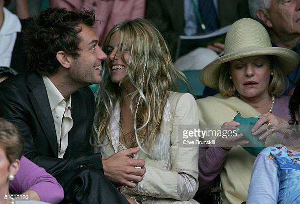 Actor Jude Law girlfriend Americanborn British television actress Sienna Miller and her mother Josephine Miller attend the quarter final match...