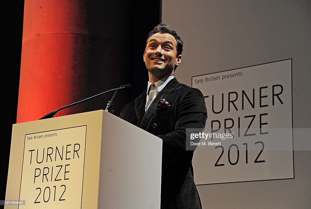 Actor Jude Law presents the Turner Prize 2012 at the winner announcement held at the Tate Britain on December 3, 2012 in London, England.