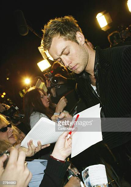Actor Jude Law signs autographs for fans at 'The Words and Music of Cold Mountain' held on December 8 2003 at Royce Holl on the campus of UCLA in Los...