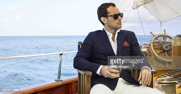 Actor Jude Law sits aboard a boat on the set of the film 'The Gentleman's Wager' at sea Johnnie Walker Blue Label has launched a partnership with...