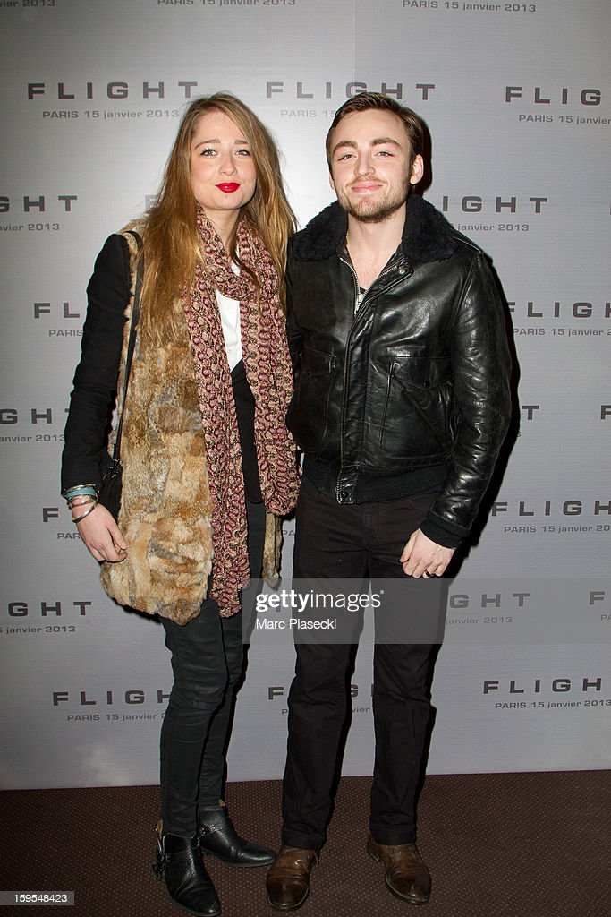 Actor Jules Pelissier (R) and guest Marie attend the 'Flight' Paris Premiere at Cinema Gaumont Marignan on January 15, 2013 in Paris, France.