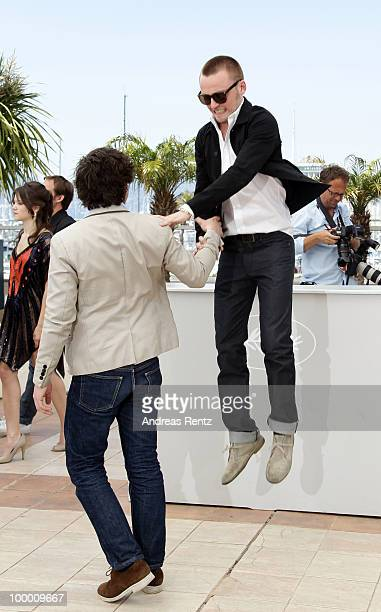 Actor Jules Pelissier jumps off the podium at the 'Lights Out' Photocall at the Palais des Festivals during the 63rd Annual Cannes Film Festival on...