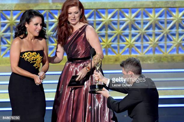 Actor Julia LouisDreyfus accepts the Outstanding Lead Actress in a Comedy Series for 'Veep' from actor Debra Messing and TV personality Chris...