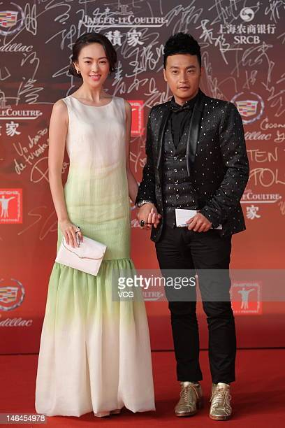 Actor Julian Chen and actress Tong Yao arrive at the red carpet during the opening ceremony for the 15th Shanghai International Film Festival at...