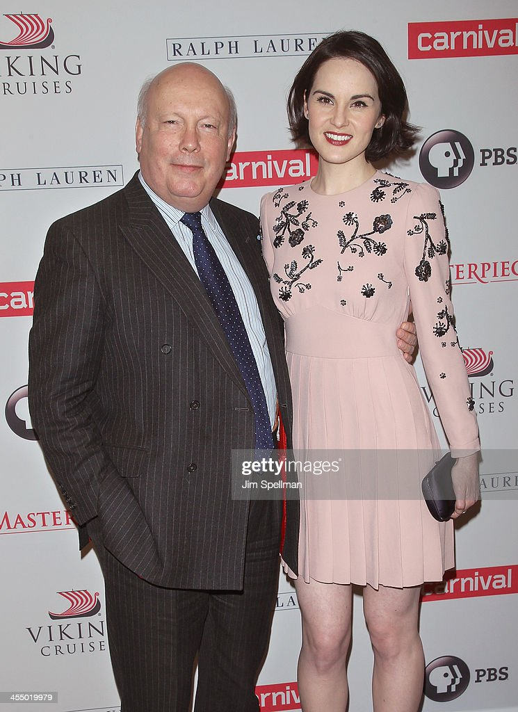 Actor <a gi-track='captionPersonalityLinkClicked' href=/galleries/search?phrase=Julian+Fellowes&family=editorial&specificpeople=224703 ng-click='$event.stopPropagation()'>Julian Fellowes</a> and actress <a gi-track='captionPersonalityLinkClicked' href=/galleries/search?phrase=Michelle+Dockery&family=editorial&specificpeople=4047702 ng-click='$event.stopPropagation()'>Michelle Dockery</a> attend 'Downton Abbey' Season Four cast photo call at Millenium Hotel on December 10, 2013 in New York City.