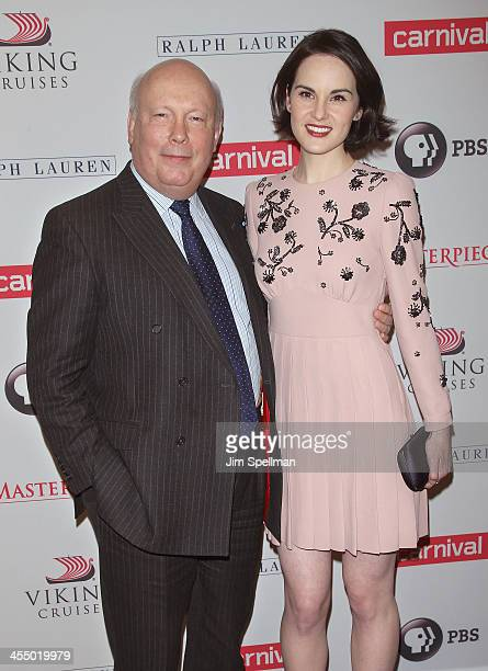Actor Julian Fellowes and actress Michelle Dockery attend 'Downton Abbey' Season Four cast photo call at Millenium Hotel on December 10 2013 in New...
