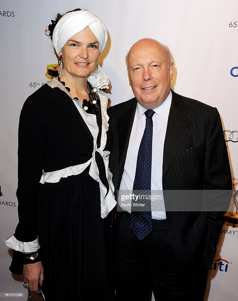 Actor Julian Fellowes (R) and his wife Emma Joy Kitchener arrive at the 65th Primetime Emmy Awards Writer Nominees reception at the Academy of Television Arts & Sciences on September 19, 2013 in No. Hollywood, California.