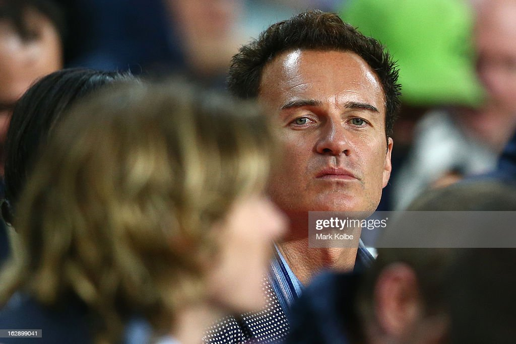 Actor <a gi-track='captionPersonalityLinkClicked' href=/galleries/search?phrase=Julian+McMahon&family=editorial&specificpeople=208755 ng-click='$event.stopPropagation()'>Julian McMahon</a> watches on from the players box during the round three Super Rugby match between the Waratahs and the Rebels at Allianz Stadium on March 1, 2013 in Sydney, Australia.