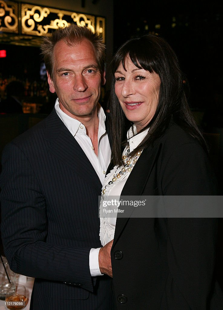 Actor Julian Sands (L) and actress Anjelica Huston (R) pose at the party for the opening night performance of 'God of Carnage' at Center Theatre Group's Ahmanson Theatre on April 13, 2011 in Los Angeles, California.