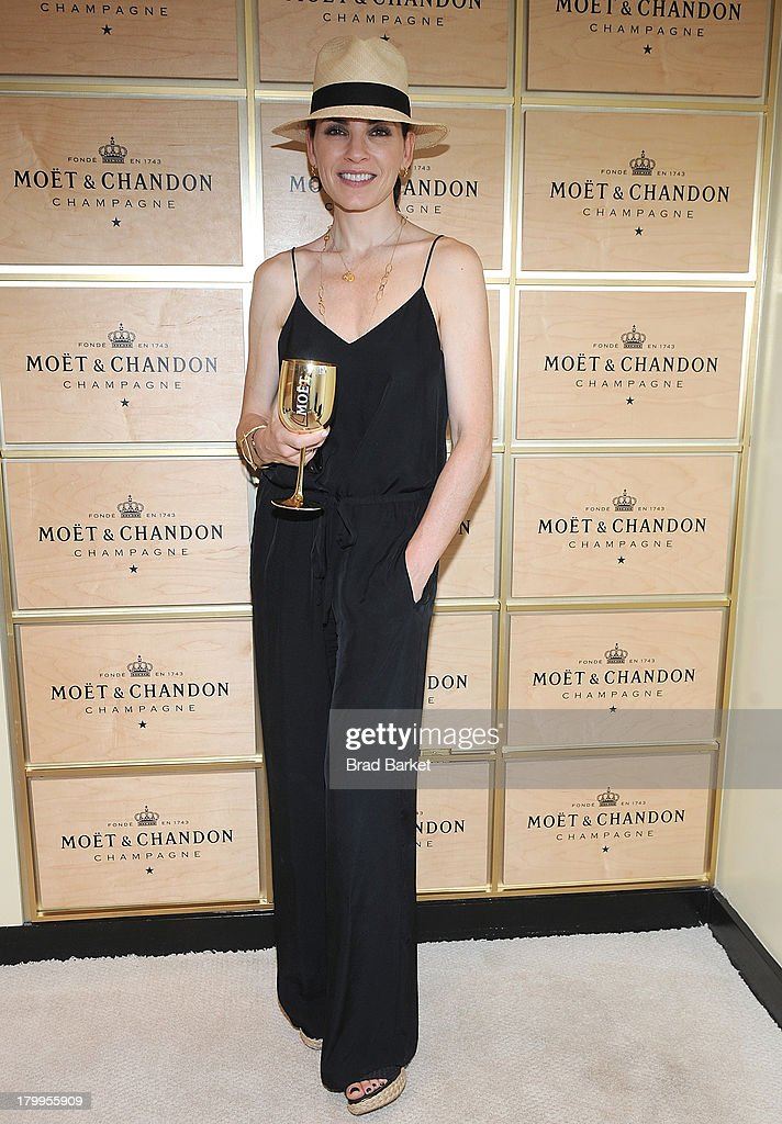 Actor <a gi-track='captionPersonalityLinkClicked' href=/galleries/search?phrase=Julianna+Margulies&family=editorial&specificpeople=208994 ng-click='$event.stopPropagation()'>Julianna Margulies</a> attends The Moet & Chandon Suite at USTA Billie Jean King National Tennis Center on September 7, 2013 in New York City.
