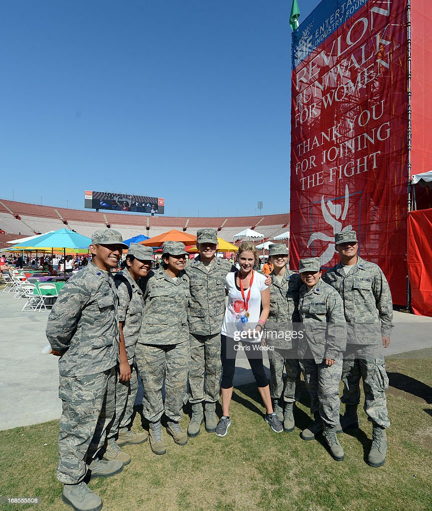 Actor Julie Bowen (C) poses with the U.S. Air Force during the 20th Annual EIF Revlon Run/Walk for Women at Los Angeles Memorial Coliseum on May 11, 2013 in Los Angeles, California.