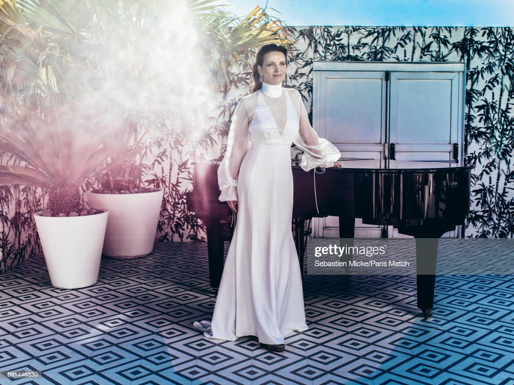 Actor Juliette Binoche wearing a dress by Chloe and Chopard jewellery is photographed for Paris Match on May 19, 2017 in Cannes, France.
