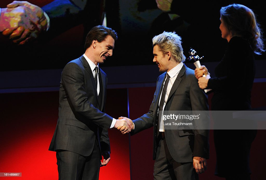 Actor Jure Henigman is congratulated by <a gi-track='captionPersonalityLinkClicked' href=/galleries/search?phrase=Julie+Delpy&family=editorial&specificpeople=201914 ng-click='$event.stopPropagation()'>Julie Delpy</a> and <a gi-track='captionPersonalityLinkClicked' href=/galleries/search?phrase=Ethan+Hawke&family=editorial&specificpeople=178274 ng-click='$event.stopPropagation()'>Ethan Hawke</a> at the Shooting Stars Stage Presentation during the 63rd Berlinale International Film Festival at the Berlinale Palast on February 11, 2013 in Berlin, Germany.