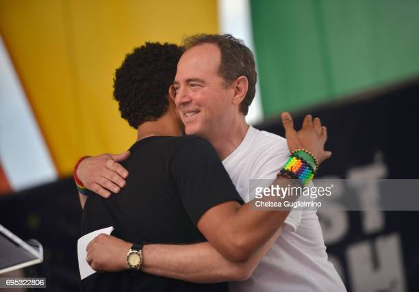 Actor Jussie Smollett hugs US Representative for California's 28th congressional district Adam Schiff during the LA Pride ResistMarch on June 11 2017...
