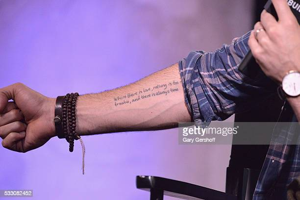 Actor Justin Baldoni tattoo detail discusses his app Belly Bump during AOL BUILD Presents Series at AOL Studios In New York on May 20 2016 in New...