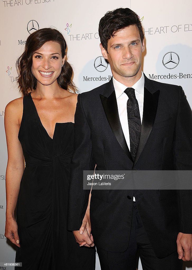 Actor Justin Bartha (R) and wife Lia Smith attend the Art of Elysium's 7th annual Heavan gala at Skirball Cultural Center on January 11, 2014 in Los Angeles, California.