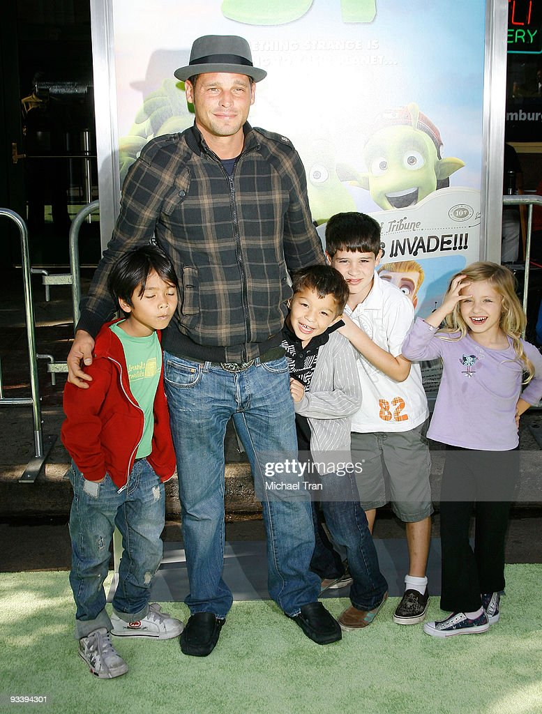 Actor Justin Chambers and family arrive to the Los Angeles premiere of 'Planet 51' held at the Mann Village Theatre on November 14 2009 in Westwood...