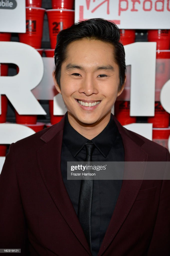 Actor <a gi-track='captionPersonalityLinkClicked' href=/galleries/search?phrase=Justin+Chon&family=editorial&specificpeople=630186 ng-click='$event.stopPropagation()'>Justin Chon</a> attends Relativity Media's '21 and Over' premiere at Westwood Village Theatre on February 21, 2013 in Westwood, California.