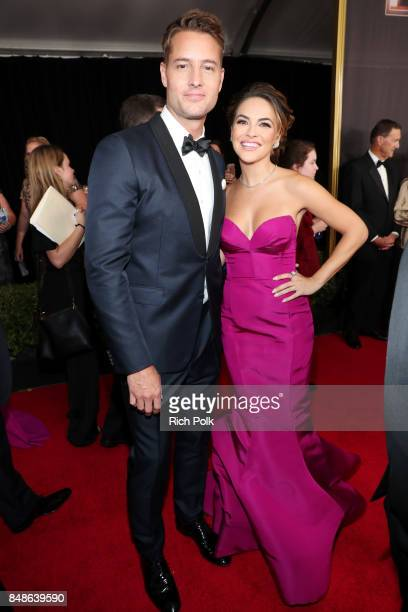 Actor Justin Hartley and Chrishell Stause walk the red carpet during the 69th Annual Primetime Emmy Awards at Microsoft Theater on September 17 2017...