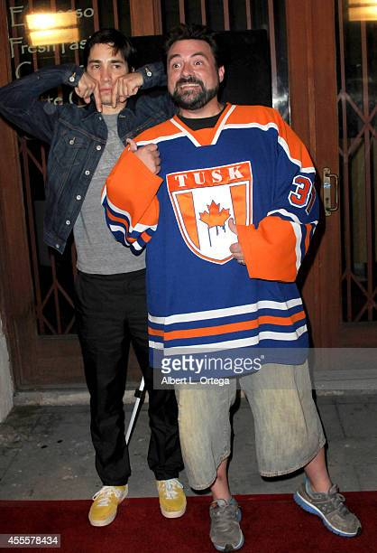 Actor Justin Long and director Kevin Smith arrive for the Premiere Of A24's 'Tusk' held at the Vista Theatre on September 16 2014 in Los Angeles...
