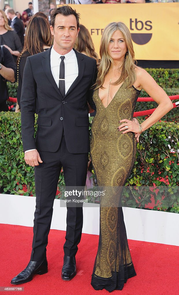Actor Justin Theroux and actress Jennifer Aniston arrive at the 21st Annual Screen Actors Guild Awards at The Shrine Auditorium on January 25, 2015 in Los Angeles, California.