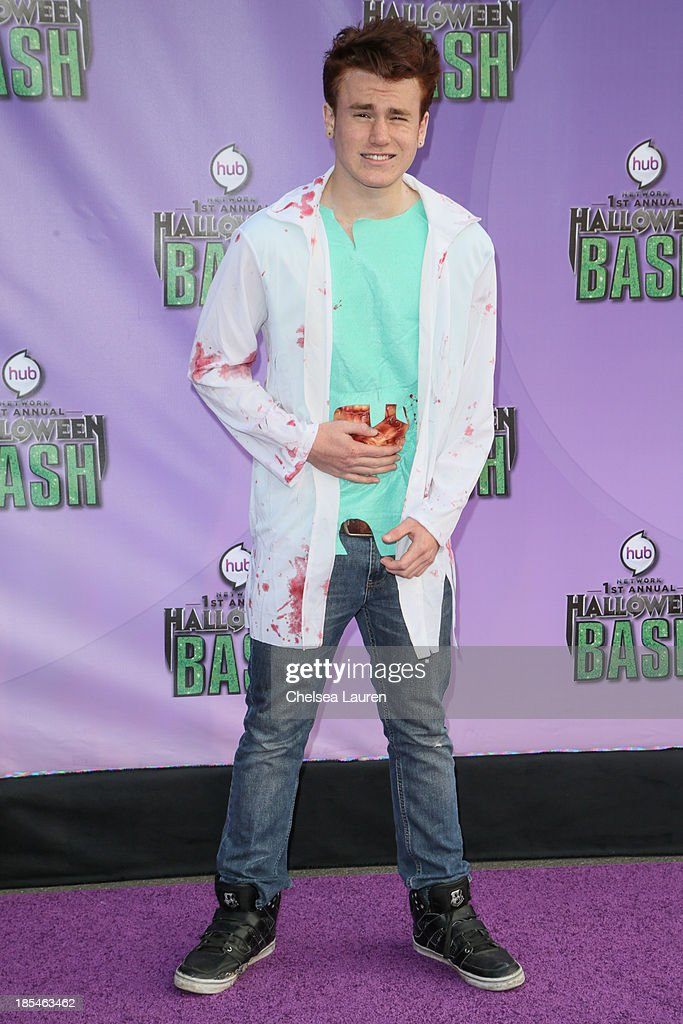 Actor Justin Tinucci arrives at Hub Network's 1st annual Halloween bash at Barker Hangar on October 20, 2013 in Santa Monica, California.