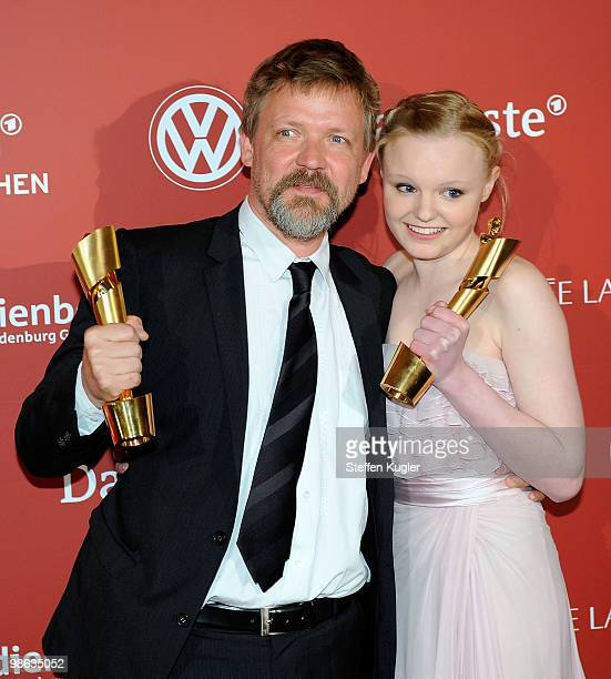 Actor Justus von Dohnanyi and actress Maria Victoria Dragus hold her Lola for best supporting actors male and female at the 60th German Film Prize...