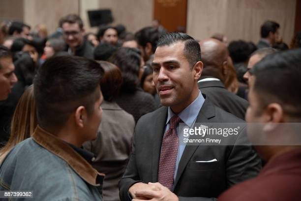 Actor JW Cortes greets attendees at the Congressional Hispanic Caucus Institute Holiday Reception benefitting Puerto Rico youth at the Library of...