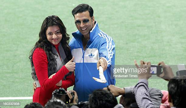 Actor Kajal Aggarwal and Akshay Kumar during Hockey India League match between Delhi Waveriders and Punjab Warriors at Major Dhyan Chand Stadium on...