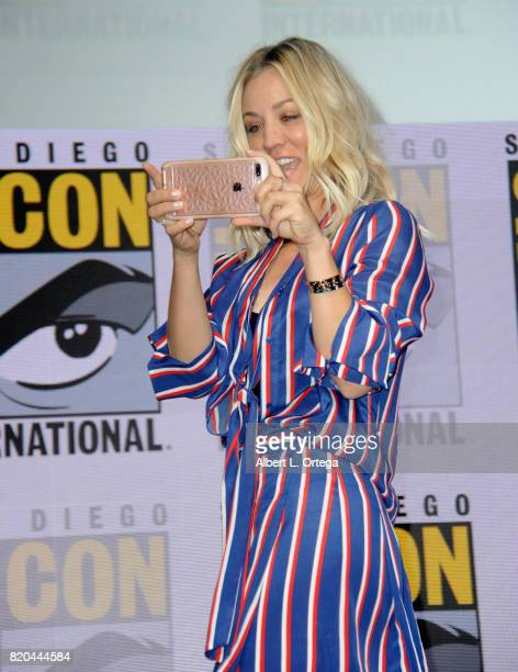 Actor Kaley Cuoco takes a photo as she walks onstage at ComicCon International 2017 'The Big Bang Theory' panel at San Diego Convention Center on...