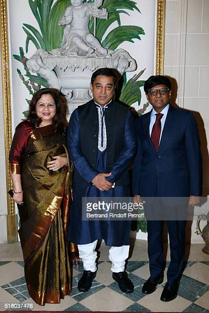 Actor Kamal Haasan standing between the Indian Ambassador to Paris Mohan Kumar and his wife Mala Kumar attend the Tribute to Indian actor and...