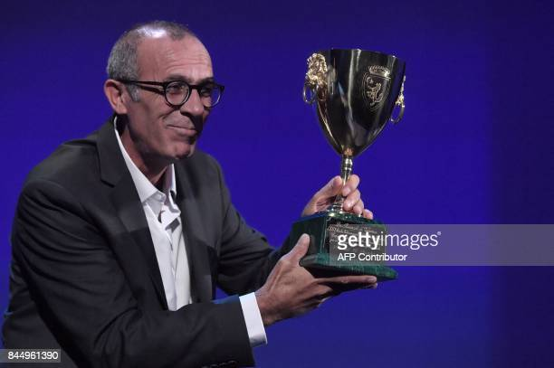 Actor Kamel El Basha receives the Coppa Volpi for Best Actor for his character in the movie 'The Insult' during the award ceremony of the 74th Venice...