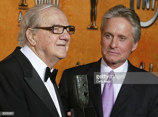 Actor Karl Maldon poses backstage with his Life Achievement Award for Career achievement and humanitarian accomplishment with actor Michael Douglas...
