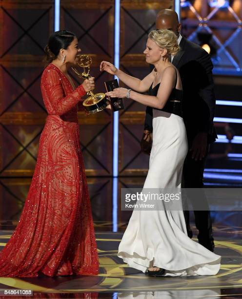 Actor Kate McKinnon accepts Outstanding Supporting Actress in a Comedy Series for 'Saturday Night Live' from actor Gina Rodriguez onstage during the...