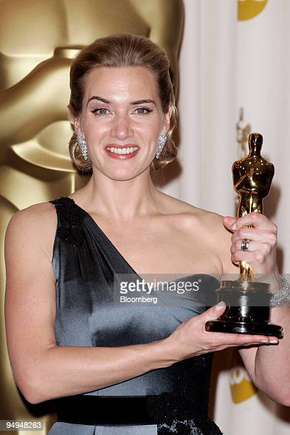 Actor Kate Winslet stands with the Best Actress award for her role in 'The Reader' during the 81st Academy Awards ceremony at the Kodak Theatre in...