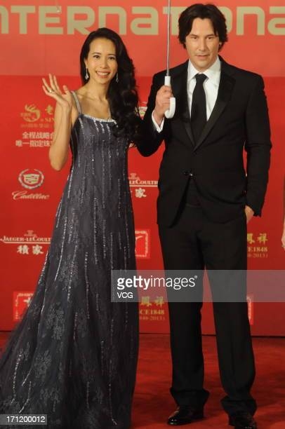 Actor Keanu Reeves and actress Karen Mok arrive at the closing ceremony of 16th Shanghai International Film Festival at Shanghai Culture Square on...