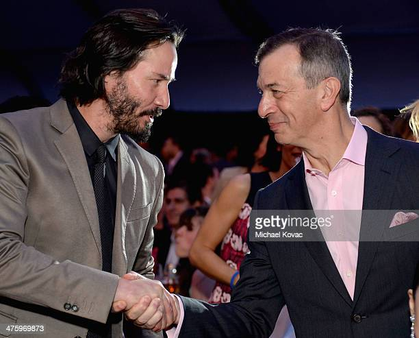 Actor Keanu Reeves and CEO of Piaget Philippe LeopoldMetzger attend the 2014 Film Independent Spirit Awards at Santa Monica Beach on March 1 2014 in...