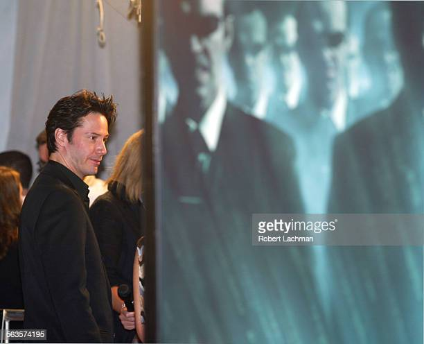 Actor Keanu Reeves comes face to face with a movie poster sporting the image of Hugo Weaving as Smith in the movie THE MATRIX REVOLUTIONS at the...