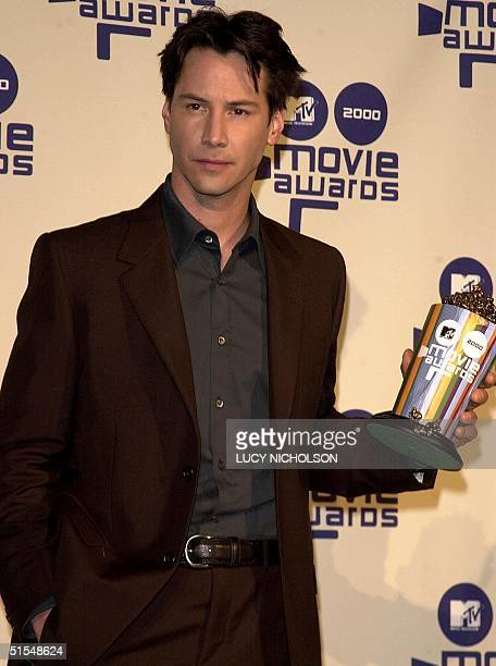 US actor Keanu Reeves poses backstage at the MTV Movie Awards after winning Best Male Performance for his role in 'The Matrix' at the Sony Studios in...