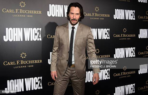 Actor Keanu Reeves poses on arrival for the premiere of the film 'John Wick Chapter 2' in Hollywood California on January 30 2017 / AFP / Frederic J...