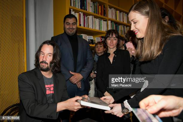 Actor Keanu Reeves signs autographs as he attends the 'X Artists' books launch at Palais De Tokyo on November 10 2017 in Paris France