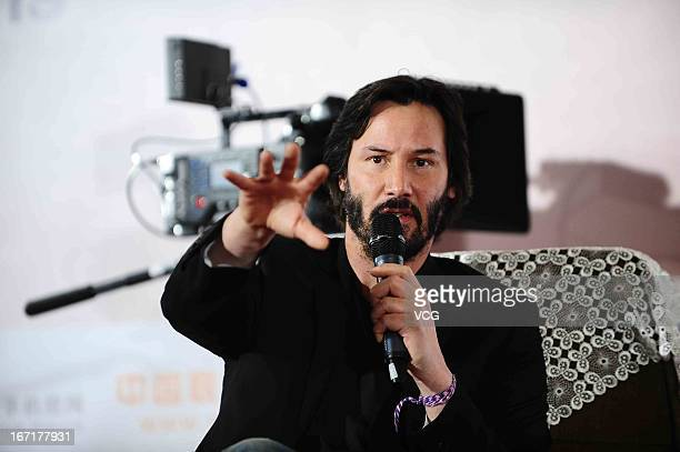 Actor Keanu Reeves speaks in front of an ARRI ALEXA digital motion picture camera during a 3D movie technology forum as a part of the 3rd Beijing...