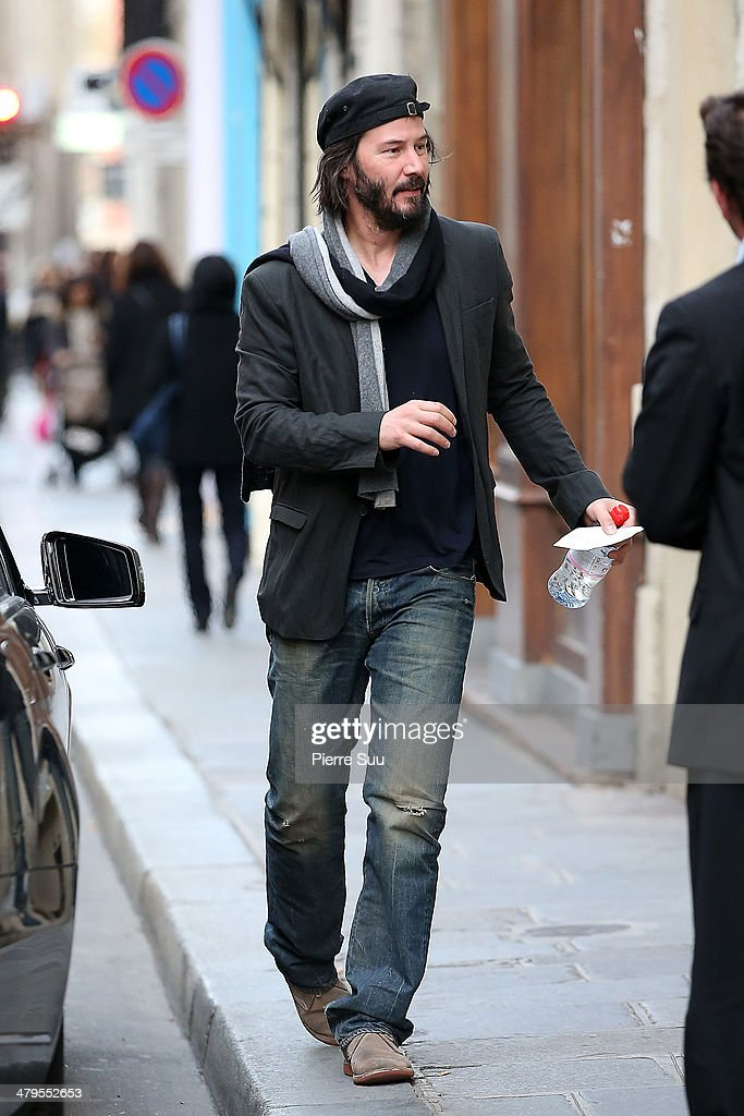 Actor <a gi-track='captionPersonalityLinkClicked' href=/galleries/search?phrase=Keanu+Reeves&family=editorial&specificpeople=171568 ng-click='$event.stopPropagation()'>Keanu Reeves</a> strolling in 'le Marais' district on March 19, 2014 in Paris, France.