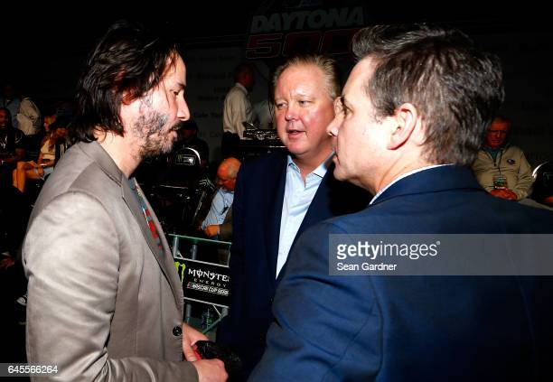 Actor Keanu Reeves talks with NASCAR Chief Executive Officer and Chairman Brian France at the drivers meeting prior to the 59th Annual DAYTONA 500 at...