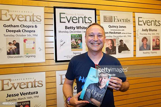 Actor Keith Coogan holds his copy of Jon Cryer's new book 'So That Happened A Memoir' at Barnes Noble 3rd Street Promenade on April 12 2015 in Santa...