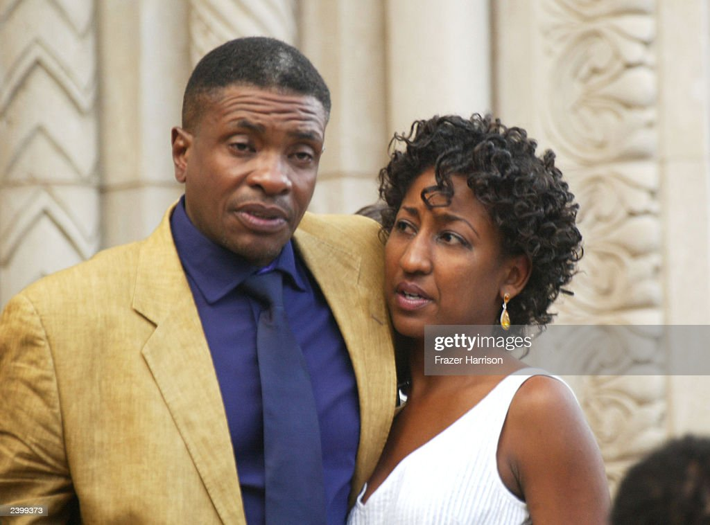 Actor Keith David hugs an unidentified guest at the memorial service at Saint Monica's Catholic Church held for actor/dancer Gregory Hines on August 13, 2003 in Santa Monica, California.